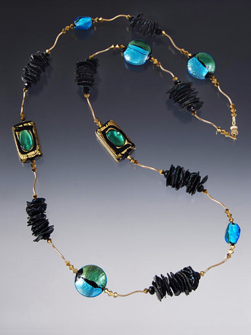 "A statement rope with gold that glitters and brilliant jewel tones right for now!      Clusters of black biwa pearls     14K curved tubes     24K Swarovski crystals     Custom designed and imported from Italy 24K gold and silver foil Venetian glass in aqua, gold, green and black      Tiny clasp that gives you the option of wearing this 35"" rope double or single     Create a special look day or night"