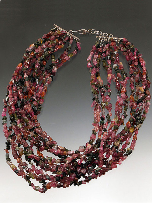 """Wear a luxurious circle of many tourmaline strands tightly coiled or loosely covering your neck.  These beautiful tourmaline chips in every shade of green, strawberry, wine and pink make a dramatic statement for any occasion. 20"""" Only two left!"""