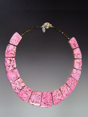 """This bright howlite geometric collar features intricately patterned pink that will blend will all your spring summer ensembles. 18"""""""