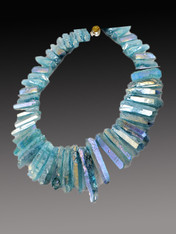 Make a dramatic statement that is perfect for spring and summer with this light aqua blue shimmering iridescent quartz collar, swarovski crystals and vintage crystal sterling clasp.