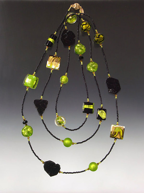 Dramatic black tourmaline, custom lime, gold, white Venetian glass, 24K plated Swarovski crystals and 14K clasp -- a rope to wrap two or three times or wear it long like a flapper! 64""