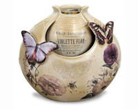 Porcelain recirculating, plug-in Butterfly fountain with Pump and pebbles Included.
