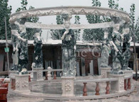 IMPRESSIVELY LARGE TWO TONE MARBLE GAZEBO WITH 8 HAND CARVED STATUES Measures: 179.5 wide x 179 tall.