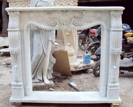 Beautifully Carved fireplace mantel and surround featuring shell, rosettes and swags. Please call for availability and color options. All Hand carved from solid block marble. Dimensions: Height 49, Width 59, Depth 12 Inside Dimensions: Height 40, Width 39