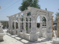 Hand carved marble gazebo with figures and benches. Measures: 28 feet long x 10 feet high x 10 feet wide