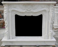 Fireplace Mantel and Surround.  Featuring heavy carvings with additional beaded style carvings on inside opening. Shown in White Marble.  Weight 660 lbs. Dimensions: Height 46.8, Width 59, Depth 16.5 Inside Dimensions: Width 30.7 ,Height 26.0.  Before purchasing please contact us for availability and for a shipping quote.