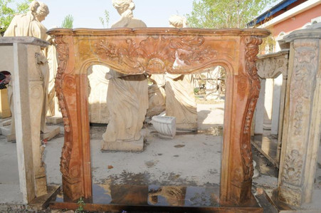 Hand carved marble fireplace mantel, shown here in Local Beige, which exhibits unique variations in each block.  This mantel's design is available in any color.  Wonderful detail throughout. French styling with leaves decorating the center piece and legs. Dimensions: Whole size is L: 59 x H: 49.6 x W: 11.8 (Inches), Opening is 37.6 x H: 35.8 (Inches).  Before purchasing, please contact us for availability and shipping quote.