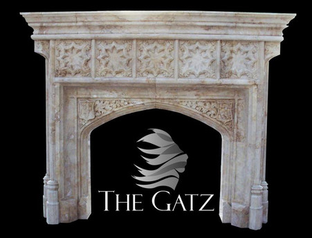 This is a custom marble fireplace that we designed with a customer. This massive mantel is really the center of attention in any room it is placed. This mantel is carved from solid blocks of marble and has intricate carvings throughout. The Gothic design gives the piece a look as if it were rescued from a European estate. Measures: 96 wide x 81 tall x 18 deep. The opening measures 52 wide x 45 tall.  Before purchasing, please contact us for availability and shipping quote.