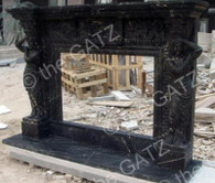 HAND CARVED BLACK MARBLE FIREPLACE MANTEL WITH CARVED WOMEN COLUMNS