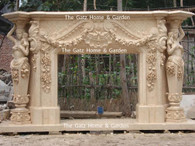 ELABORATE HAND CARVED MARBLE FIREPLACE MANTEL IN EGYPTIAN YELLOW WITH LARGE FEMALE STATUES