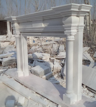 """Hand carved marble fireplace mantel all carved from white marble. Very simple but elegant Greco Roman design with columns and contoured header supporting a tapered mantel shelf. Measures: 76"""" wide x 52"""" tall. Opening Measures: 36"""" tall x 48"""" wide."""