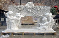 New design of a cherub fireplace mantel. This is just an overall fun design. Four cherub angels are pulling back the curtains to the firebox opening. This would be the perfect compliment for any home theater or entertainment room. This mantel was all hand carved from a single block of marble. Measures: 82.75 wide x 53.25 tall x 21.75 deep