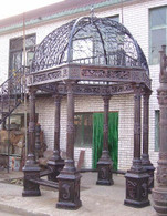 "CAST IRON GAZEBO WITH 6 CORINTHIAN CAPITALS, WROUGHT IRON DOME AND BENCH SEATING, 118"" TALL"