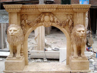 This is a lovely hand carved fireplace mantel with a lion motif. If you are looking for a statement piece this is it! This was carved from brown Travertine but we can reproduce it in any color. Please call to confirm arrival/availability before purchasing. Ask about our in store layaway plans. This wonderful design really is the best of the best when it comes to carving quality.  Overall dimensions: 86 x 65 x 18 Opening width: 42 wide x 42 tall Brown Travertine