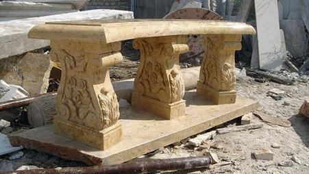 HAND CARVED MARBLE GARDEN BENCH, HEAVILY CARVED LEGS IN SOLID BEIGE Measures: 55 wide x 14 deep x 20 tall.
