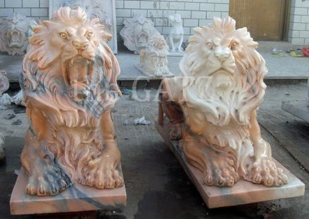 PAIR OF HAND CARVED MARBLE ESTATE LIONS LAYING DOWN, SUNSET PINK MARBLE