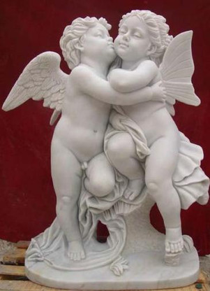 Detailed carvings on this marble statue featuring a young boy angel kissing a young girl fairy. Very sweet! Height is 31.50 inches. Please call on availability and color options.