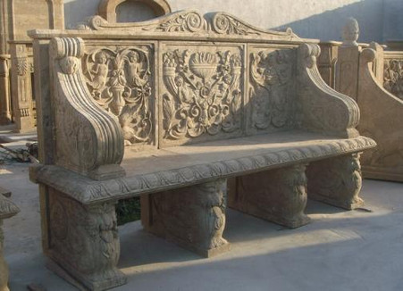 SOLID MARBLE BENCH FEATURES FLORAL CARVINGS AND SMALL CHERUBS