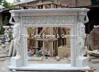 MARBLE FIREPLACE MANTEL AND SURROUND FEATURING FIGURAL CARVINGS AND GRAPE AND LEAF CARVINGS Dimensions: 71.5 wide x 51.5 tall x 14 deep