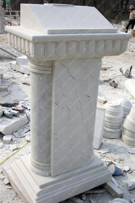 New hand carved Marble church podium. This is all hand carved from a single block of marble. We have already drilled a hole for easy electrical installation. This can be recarved in a wide variety of colors and sizes. Measures: 53 tall x 27.75 wide x 19 deep.