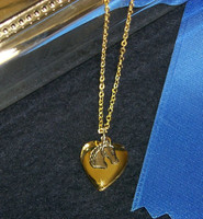 Gold Locket with Silver Charm