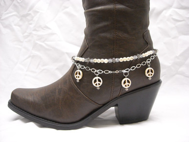 """Boot Candy is the best thing to happen to your boots since you broke them in... This item contains Natural Howlite, White beads and sparkling clear Czech crystals.  The accent silver plated chain holds 4 Natural Howlite, White Peace charms.  Adjustable to fit your cowboy boots, your fashion boots and your winter boots, too! Length:  14.25"""" to 15.75"""" adjustable. Made in Texas, USA."""