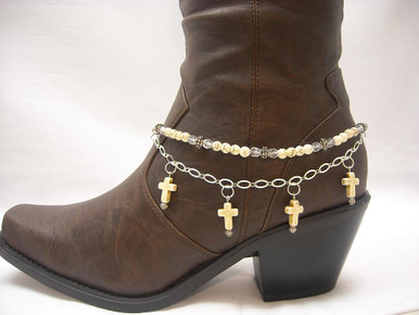 """Boot Candy is the best thing to happen to your boots since you broke them in... This item contains Natural Howlite, White beads and sparkling clear Czech crystals.  The accent silver plated chain holds 4 Natural Howlite, White Cross charms.  Adjustable to fit your cowboy boots, your fashion boots and your winter boots, too! Length:  14.25"""" to 15.75"""" adjustable. Made in Texas, USA."""