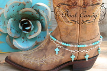 "Boot Candy is the best thing to happen to your boots since you broke them in... This item contains Natural Howlite, dyed Turquoise beads and sparkling clear Czech crystals.  The accent silver plated chain holds 4 Natural Howlite, dyed Turquoise Cross charms.  Adjustable to fit your cowboy boots, your fashion boots and your winter boots, too! Length:  14.25"" to 15.75"" adjustable. Made in Texas, USA."