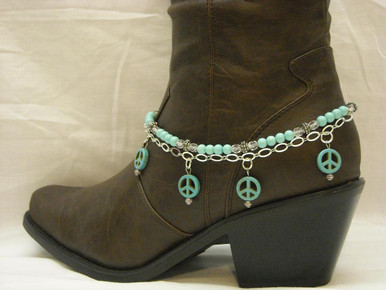 """Boot Candy is the best thing to happen to your boots since you broke them in... This item contains Natural Howlite, dyed Turquoise beads and sparkling clear Czech crystals.  The accent silver plated chain holds 4 Natural Howlite, dyed Turquoise Peace charms.  Adjustable to fit your cowboy boots, your fashion boots and your winter boots, too! Length:  14.25"""" to 15.75"""" adjustable. Made in Texas, USA."""