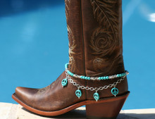 "Boot Candy is the best thing to happen to your boots since you broke them in... This item contains Natural Howlite, dyed Turquoise beads and sparkling clear Czech crystals.  The accent silver plated chain holds 4 Natural Howlite, dyed Turquoise Peace charms.  Adjustable to fit your cowboy boots, your fashion boots and your winter boots, too! Length:  14.25"" to 15.75"" adjustable. Made in Texas, USA."