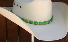 "CTL Hat Bands are made of Colored Gem Stones and Leather Lace.  This CTL Hat Band contains Green Ovals and Gun Metal Round Beads.   The Black leather Lace is accented with the same Colored Stones and ties in the back of the hat.  The Gem Stone Strand measures 20"" and the Leather Lace Measures 14"" and will drape down the back if your hat."