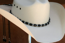 "CTL Hat Bands are made of Colored Gem Stones and Leather Lace.  This CTL Hat Band contains Black Ovals with Gun Metal Round Beads.   The Black leather Lace is accented with the same Colored Stones and ties in the back of the hat.  The Gem Stone Strand measures 20"" and the Leather Lace Measures 14"" and will drape down the back if your hat."
