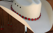 "CTL Hat Bands are made of Colored Gem Stones and Leather Lace.  This CTL Hat Band contains Red Ovals with Turquoise Round Beads.   The Black leather Lace is accented with the same Colored Stones and ties in the back of the hat.  The Gem Stone Strand measures 20"" and the Leather Lace Measures 14"" and will drape down the back if your hat."