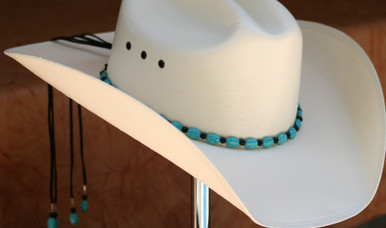 "CTL Hat Bands are made of Colored Gem Stones and Leather Lace.  This CTL Hat Band contains Turquoise Ovals with Black Round Beads.   The Black leather Lace is accented with the same Colored Stones and ties in the back of the hat.  The Gem Stone Strand measures 20"" and the Leather Lace Measures 14"" and will drape down the back if your hat."