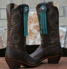 "Boot Candy Toppers,   attach to the tops of your Boots thru the Pull Straps.  This pair of Boot Candy Boot Toppers have Turquoise Leather Fringe with Antique Berry Concho and Chains.  Add subtle elegance to your boots.  Fringe measures 7"",  Concho measures 1.5""   We are Made in the USA."