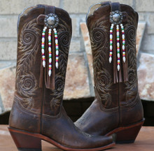 "Boot Candy Toppers,   attach to the tops of your Boots thru the Pull Straps.  This pair of Boot Candy Boot Toppers has Distressed Tan Leather Fringe with an Antique Berry Concho and Aztec Influenced Design white Beads and Multi Colored Accents.   Add subtle elegance to your boots.  Fringe measures 7"",  Concho measures 1.5""   We are Made in the USA."