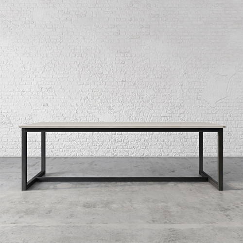 "The Union Concrete Table, shown in the color ""Concrete"" with ""Industrial Dark"" base finish. TBL-UNION-C."