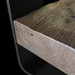 Close-up of Outland Vanity with concrete sink, steel base and wood shelves