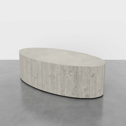 "Aspen Oval Concrete Coffee Table by Trueform Concrete. Pictured here in the color ""Limestone""."