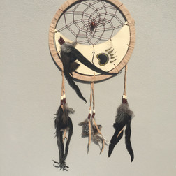 Dream catcher with half leather inside.