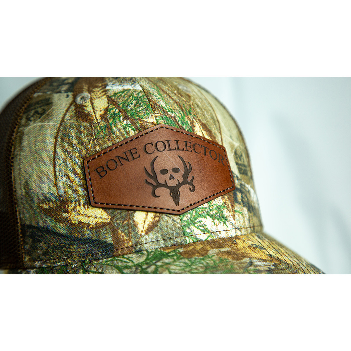 bone collector edge snapback leather hat close up