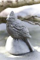 Campania Stone cardinal bird statue.