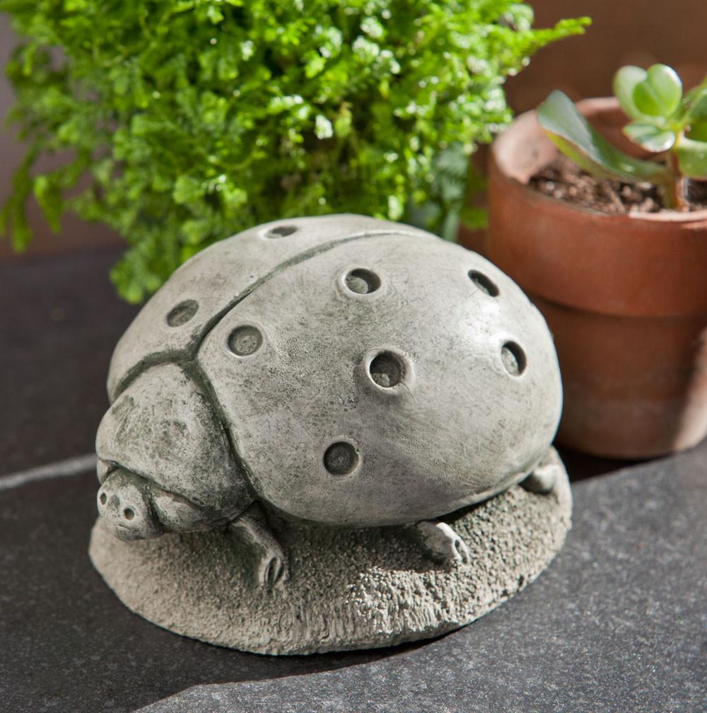 Campania Stone ladybug statue.