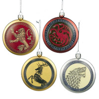 """This 4 piece Game of Thrones ornament set will surely make your friends jealous. This set features 4 ornaments depicting the houses from the popular television show. Targaryen Shield features a dragon on the front and the quote, """"Fire and Blood."""" Baratheon shield features a Stag on the front and the quote, """" Ours is the Fury."""" Lannister Shield features a Lion on the front, and the quote, """" Hear Me Roar."""" Stark shield features a Direwold on the front and the quote, """"Winter is Coming."""" Each ornament is approximately 4 inches in diameter."""