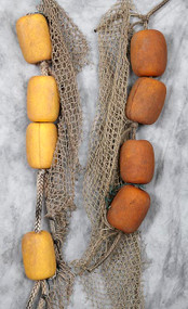 4 used Floats with attached rope and a bonus piece of net attached.
