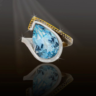 Fabulous New Age Woman Blue Topaz Energy Ring