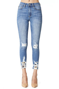 The Farrah High Rise Distressed Ankle Jeans with Leopard