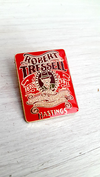 Image has the the following text:  Robert Tressell 1870-1911 House painter, Signwriter The Ragged Trousered Philanthropists Hastings  With an image of the author at its centre.