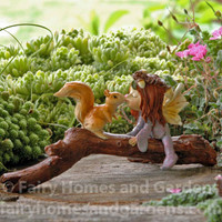 Little Fairy Kissing Squirrel on Branch