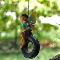 Fairy Boy on Tire Swing